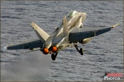 A Boeing F/A-18C Hornet (Known as a Legacy Hornet) is catapulted off the deck of the USS Abraham Lincoln Aircraft Carrier - Photo by Britt Dietz