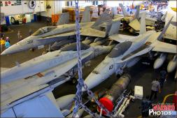 Packed in like fitting pieces of a jigsaw puzzle, F/A-18C Hornets are carefully placed utilizing the least amount of space possible in the hangar deck of the USS Abraham Lincoln - Photo by Britt Dietz