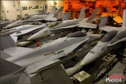 Very neatly and carefully packed F/A-18C Hornets form a sort-of mazed wall in the hangar deck of the USS Abraham Lincoln Aircraft Carrier - Photo by Britt Dietz