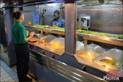 One of the many food serving stations in the massive Mess Hall section of the USS Abraham Lincoln Aircraft Carrier - Photo by Britt Dietz
