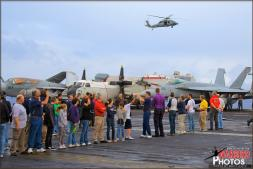 Tigers line up on the flight deck of the United States Navy USS Abraham Lincoln Aircraft Carrier for a large group photo waving at the MH-60S Seahawk helicopter that hovers overhead waiting to take the photo. - Photo by Britt Dietz