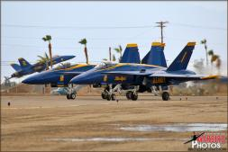 USN Blue Angels #1 and #2 taxi out to start the second Blue Angel practice of the day with the distant El Centro Blue Angel 'Gate Guard' in the background. - Photo by Britt Dietz
