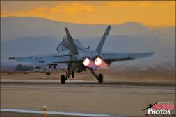 A Boeing F/A-18C Hornet from VMFAT-101 'Sharpshooters' based at MCAS Miramar launches into the sunset skies with afterburners lit at Naval Air Facility El Centro  - Photo by Britt Dietz