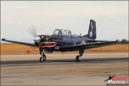 A Beechcraft T-34C Mentor from VMFAT-101 'Sharpshooters' lands on the main runway at Naval Air Facility El Centro from MCAS Miramar during the Photocall - Photo by Britt Dietz
