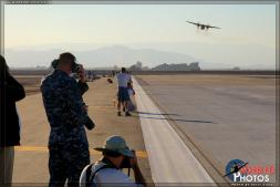 "Photographers line the runway of Naval Air Facility El Centro as a Grumman C-2A Greyhound from VRC-30 ""Providers"" comes in for a touch and go simulated aircraft carrier landing. - Photo by Britt Dietz"
