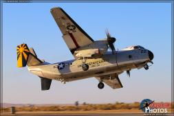 "A Grumman C-2A Greyhound from VRC-30 ""Providers"" banks away hard while performing a touch and go simulated aircraft carrier landing. - Photo by Britt Dietz"